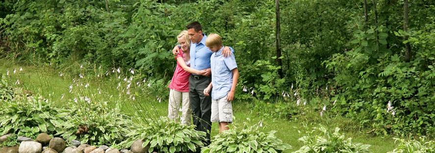 Family Standing at Garden